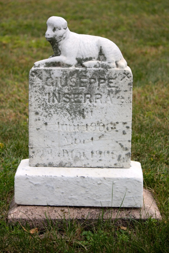 One of several grave markers of babies and young children topped by a lamb, representing innocence.