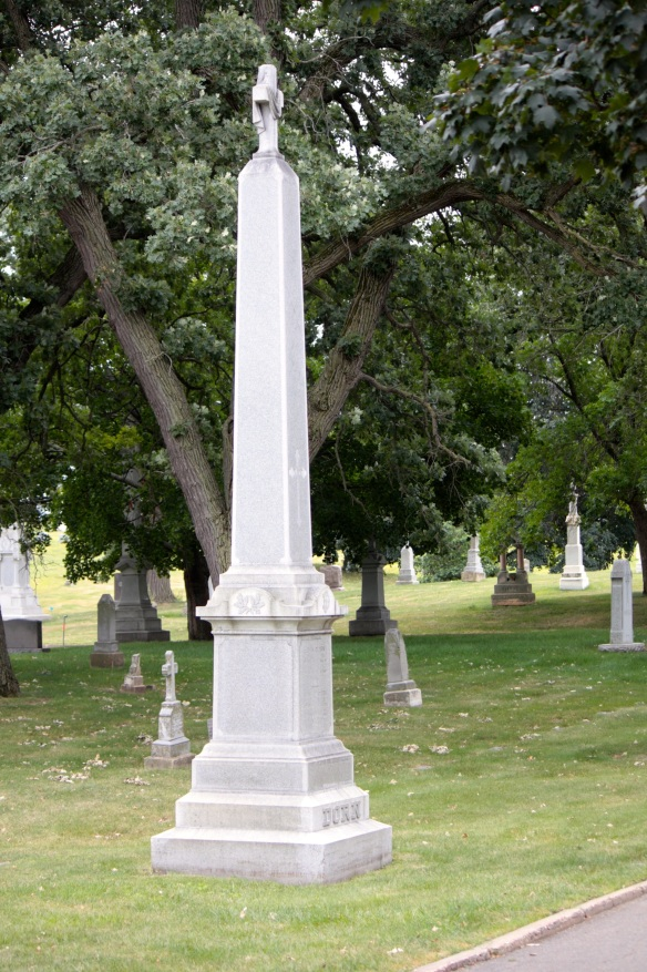 A larger memorial marker. The oak leaves represent enduring faith.