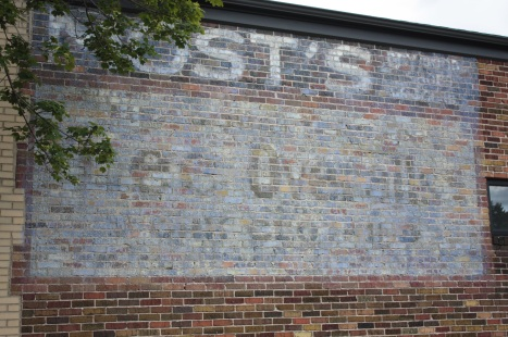 A fading but still readable ad for Most's and Lee Overalls on the wall of 1026 Front Avenue.