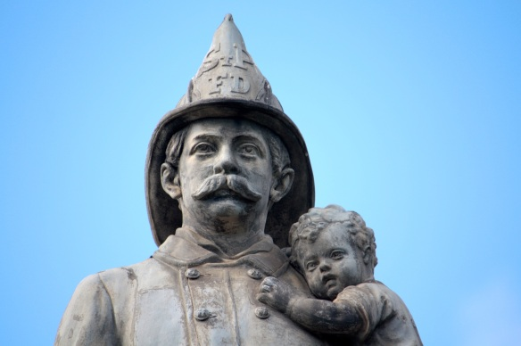 TThe elaborately sculpted statue atop the Firefighters Memorial is almost life-like, even up close.