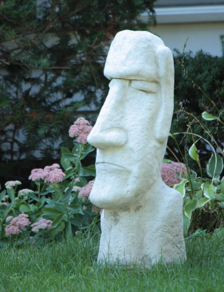 The statue at 493 Mount Curve Avenue is reminiscent of those on Easter Island.