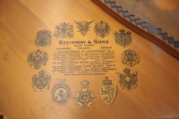 The names and coats of arms of some of the world's leaders who owned Steinway and Sons pianos around 1912.