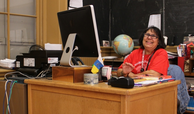 Carmen Lundberg shares a laugh from her desk inside the former Mattocks School.