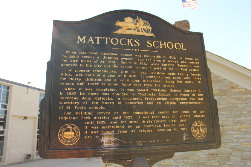 The historic plaque beside the school.