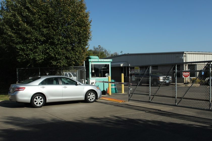 The main gate into the National Car Rental maintenance facility on Stewart Avenue, just south of Sibley Manor.