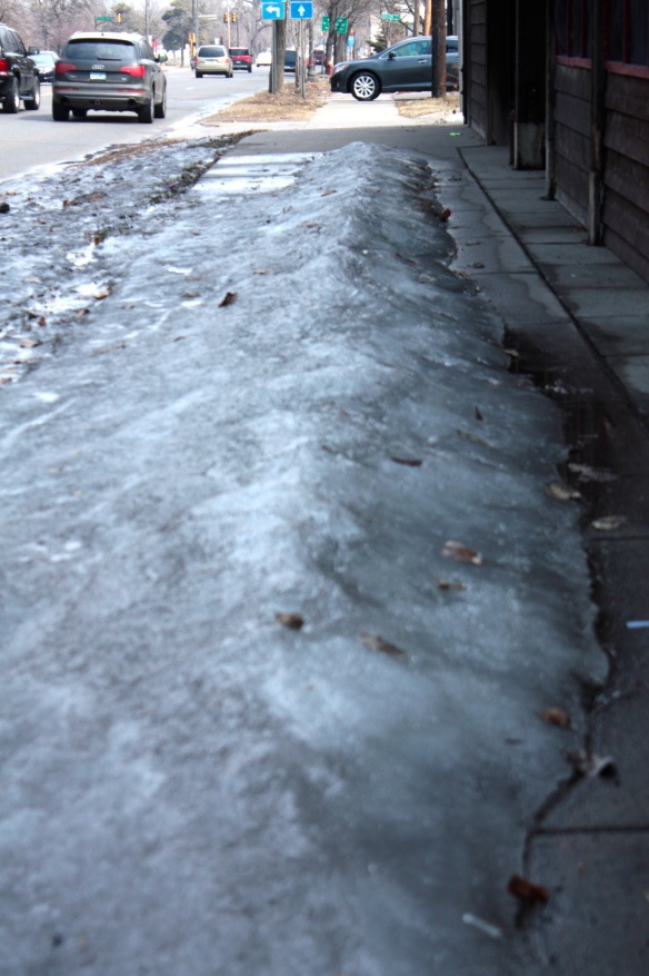 Packed ice is in retreat but still covered most of this section of sidewalk in the 1900 block of West 7th.