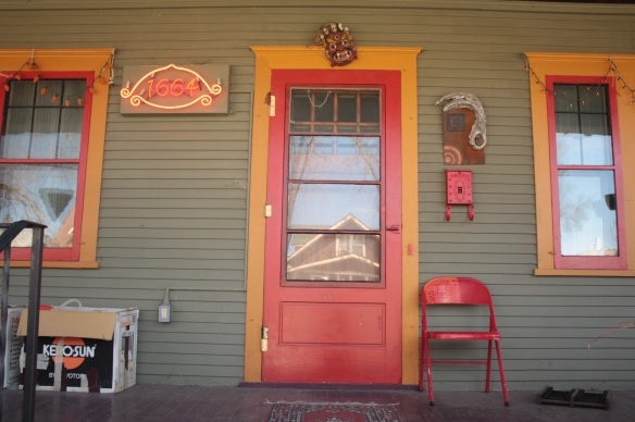 An array of art, including a neon address sign, decorate 1664 Hague.