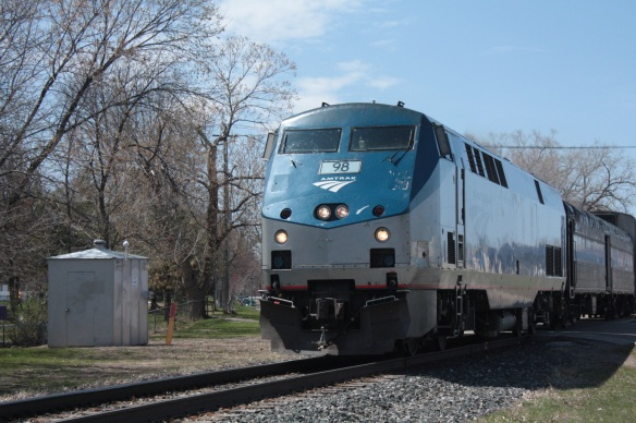 "The Amtrak train ""Empire Builder"" crosses Pierce Street about six hours late on its way east to Milwaukee and Chicago."