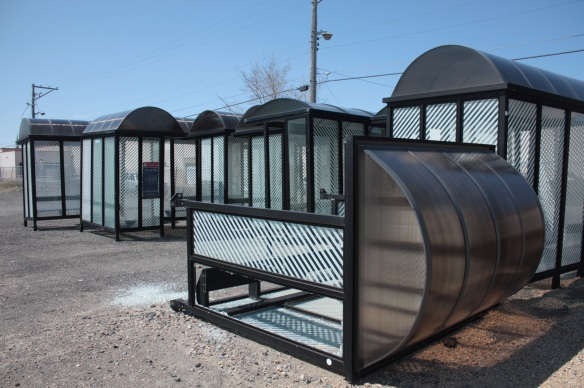 It's not just buses. Surplus bus shelters sit…and lay…ready for disposal.
