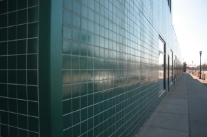 The green tiles and windows along the University Avenue side of Spruce Tree Center.