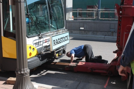 Metro Transit employees ready a broken down bus for the trip to an East Side maintenance base.