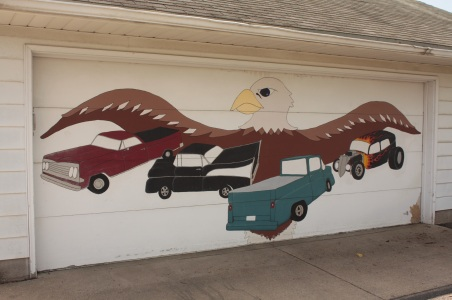 I get the classic car part of this garage door painting but I'm confused about the presence of the eagle. Photo taken in an alley off St. Clair and Wheeler in Mac-Groveland.