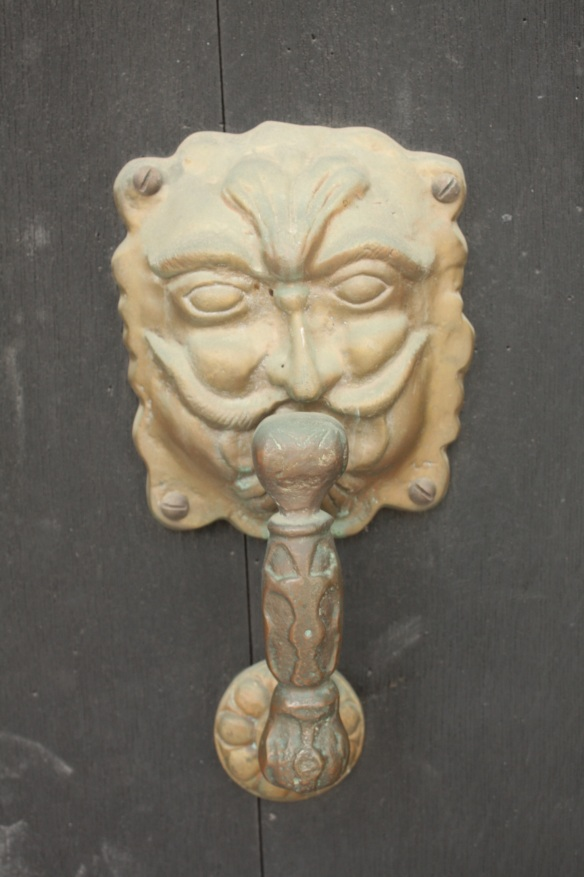 A mustachioed man door knocker.