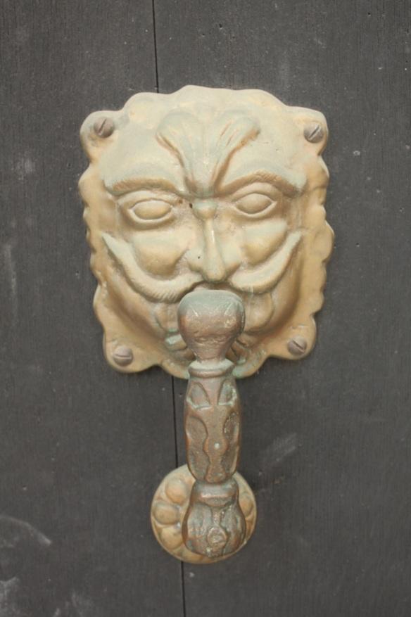 A mustachioed man door knocker.