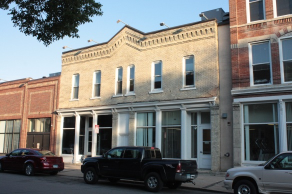 One C.R. Biglo operated a tinware business in the white brick building at 374 Dayton. Tinware usually referred to eating utensils crafted from tin.
