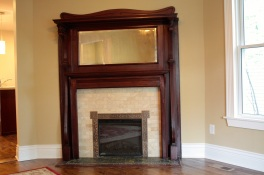 A salvaged period fireplace that Paul found looks perfect in the living room.