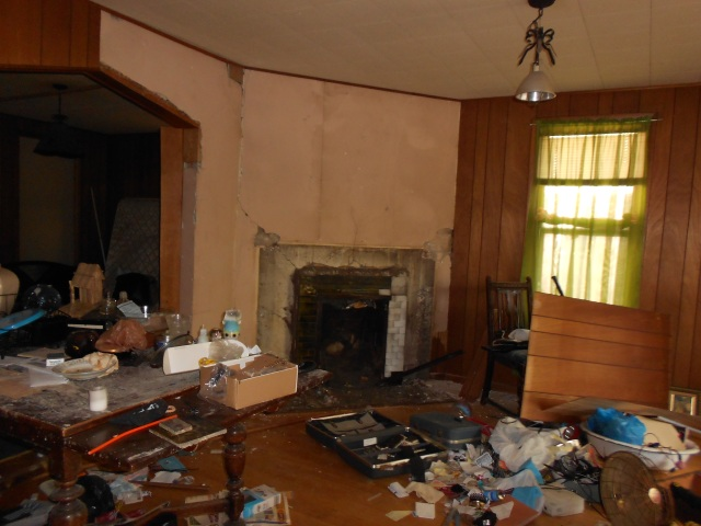 Previous tenants trashed the living room of 869 Fuller.