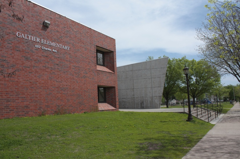 Galtier Elementary School at Charles and Hamline Avenue is named for one of Saint Paul's early European settlers, Father Lucien Galtier, who came to the hamlet of Pig's Eye in 1841. Father Galtier built a log chapel on a bluff above the Mississippi River in what today is downtown.