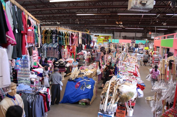 Clothing and cookware are stacked from floor to ceiling at the Hmongtown Market.