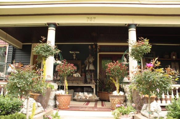 As you approach the front door, details of the imaginatively decorated porch come into view.