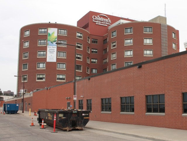 Two facilities are always under construction-major airports and hospitals. The dumpsters confirm a project is ongoing at Children's and/or United Hospital.