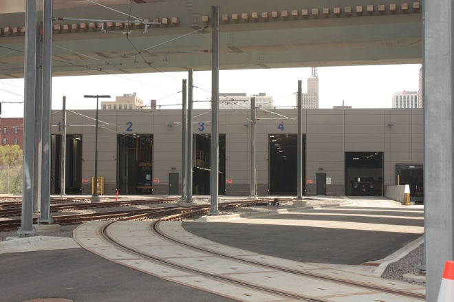 Four east-facing maintenance bays. You can see a car in Bay 2. There are several more maintenance bays out of frame to the right.