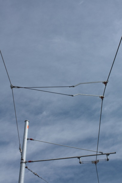 Overhead power lines for the cars.