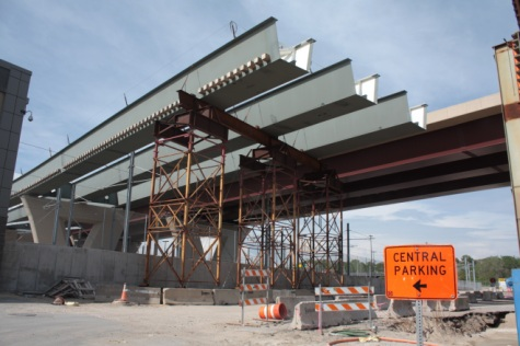 Meanwhile, construction of the new Lafayette Freeway bridge progresses nearly above the maintenance building.