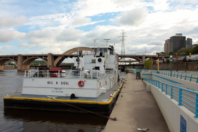 Towboats usually dock at Lambert's Landing when in Saint Paul. Downtown is on the right and the Robert Street Bridge is on the left.