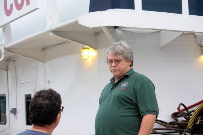The author, standing on Lambert's Landing, interviews Captain Darrel Lance of the Neil N. Diehl.