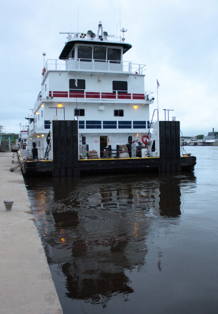 Tow is a misnomer because the Neil N. Diehl and similar vessels push the barges up and down the river.