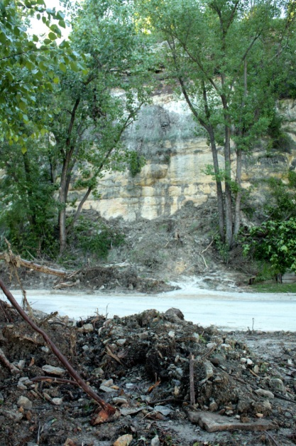 Debris left along Crosby Park Road by flooding earlier in the spring.
