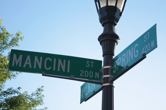 The Spring and Wilkin Street names have been reclaimed from the old neighborhood. Mancini was named in honor of Nick Mancini, the well-known West 7th Street restaurateur who died in 200000???