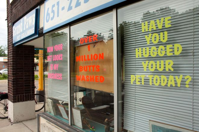 "Across Hamline from Groundswell is Grand Paws Pet Grooming. There are signs in four windows along Hamline but the notice that garners the most attention has to be the one with the orange lettering. Yes, it says, ""Over 1 million butts washed."""