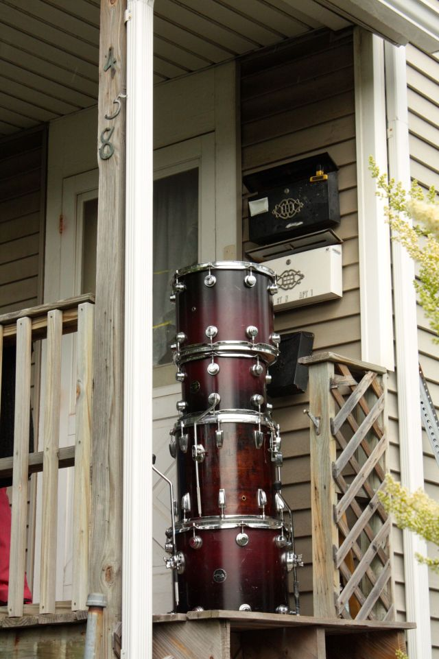 Gilbert Avenue is the north frontage road of I-94 between Prior and Cleveland in Merriam Park. There is a community garden, a car repair facility and one house along Gilbert where these drums sat, neatly stacked on the on the front porch.