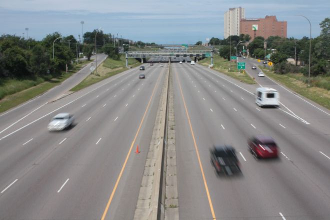 Cars speed along I-94.  It's been more than 50 years since the Rondo neighborhood made way for this highway.
