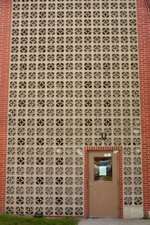 The decorative block incorporated into the 1961 building is visual revelry.