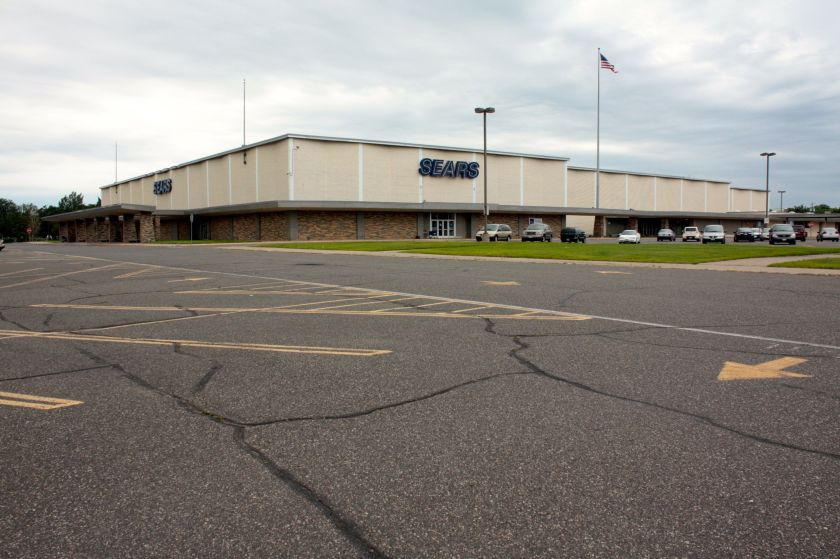 The suburban-style Sears store as viewed from the east, near Rice Street.