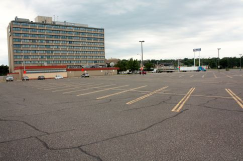 The view looking south from the Sears parking lot. The Kelly Inn, home to many state legislators during session, is in the background.