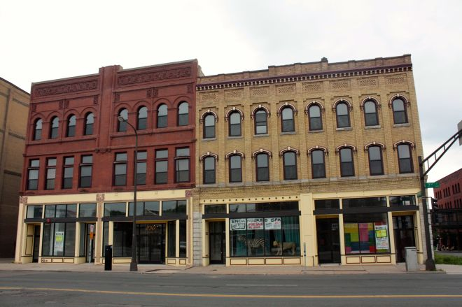 If you can block out the East 7th Street traffic, you can transport yourself to a bygone era. The three buildings on the south side of East 7th between Wacouta and Wall are among the best examples, with their brick work, arched windows and decorative facades.