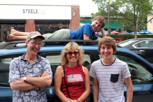Parker and his family. From left to right, Dad John, Mom Lori, Parker and brother Elliot on top of the car.