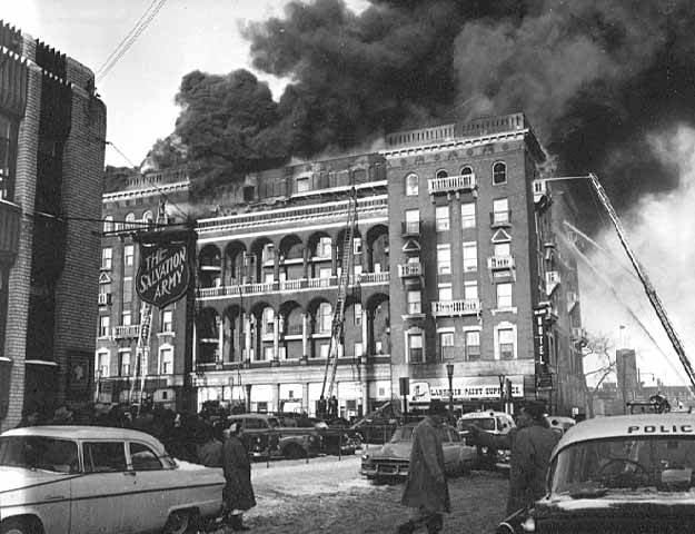 Multiple fire crews struggle to put out the extensive blaze that killed a maid at the Willard Hotel on December 13, 1955.