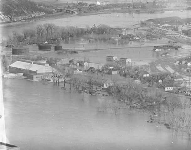 The Mississippi River is in the foreground and the Flats just beyond in this picture taken from the First National Bank Building Downtown. Minnesota Historical Society.