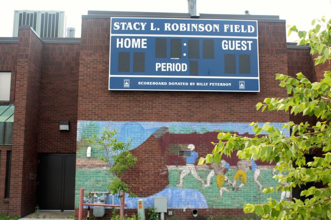 A scoreboard and mural welcome all to Stacy Robinson Field, part of Oxford Community Center.