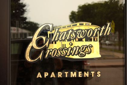 The logo on the door of the Chatsworth Crossing Apartments is a reminder of the streetcars that traversed Selby Avenue until the mid-1950s. Chatsworth Crossing is one building east of