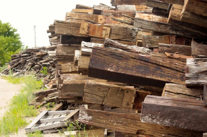 Discarded railroad ties are piled high along the gravel-covered extension of Alabama Street.