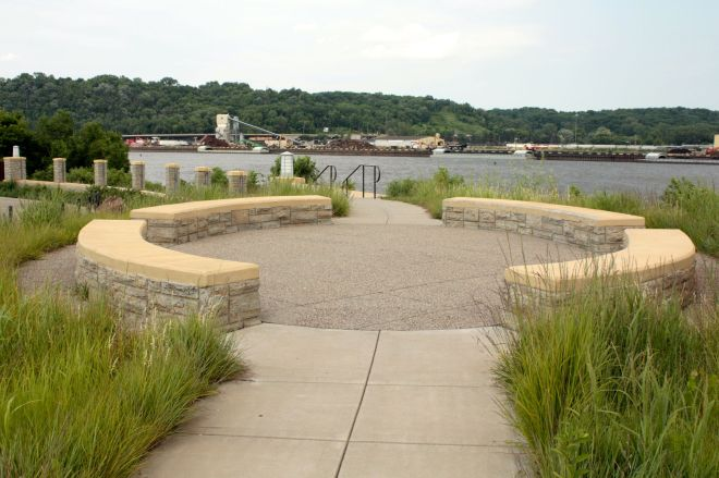 This serene spot carries the dispassionate name of the Holman Airfield Floodwall Overlook. One can bike, drive and hike to this pleasant setting to watch planes take off and land, barges float by and birds flutter past.)
