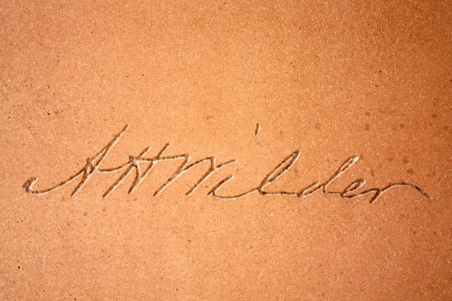 Signatures of several members of the Wilder family were etched into the building facade. This is Amherst Wilder's signature.