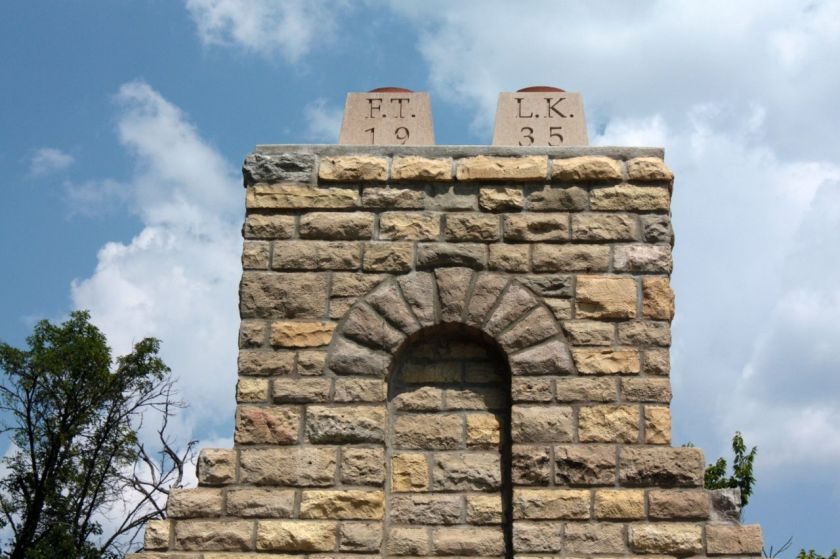 The chimney of the fireplace has the date construction began and the initials of LaMont Kaufman, Superintendent of Parks, and Park commissioner Fred Truax.