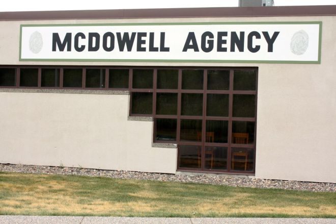 """The sign on this plain building gives a clue as to what the McDowell Agency does. On either side of the sign, you'll notice, are fingerprints, and the company is a private investigation firm that specializes in background investigations, according to the website. It goes on to say products and services include """"criminal background screening"""" and the nebulous """"additional verification services"""" and """"industry specific services."""""""